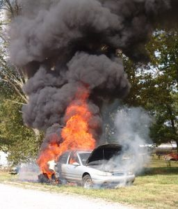 Burning car engulfed in flames.