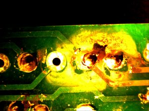 An electrical short on a circuit board caused by water intrusion.
